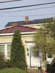Mark Frazar's yellow Clifton home is shown at right on William Street, with the solar panels visible on the roof in back.