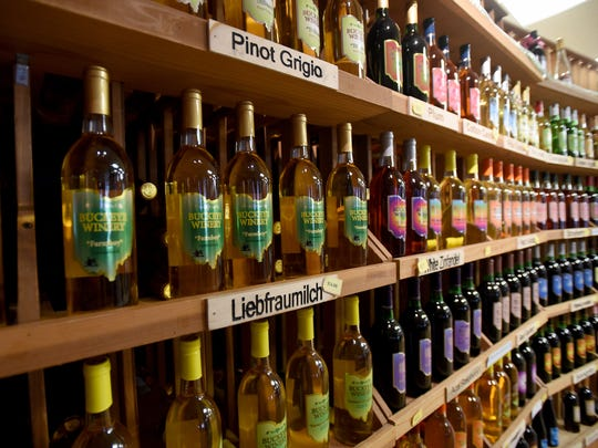 Wall of wine bottles from Buckeye Winery on the square
