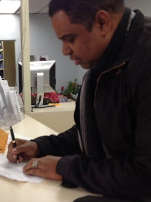 Diomedes Minaya signs his candidacy petition in the 2017 Passaic mayoral race.