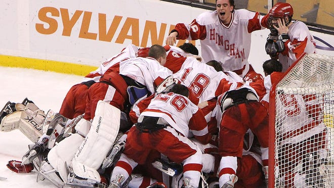Hingham players mob goalie Derek McInnis at the conclusion of the Hingham's 1-0 victory over Catholic Memorial in the Super Eight championship game at TD Garden in 2010.