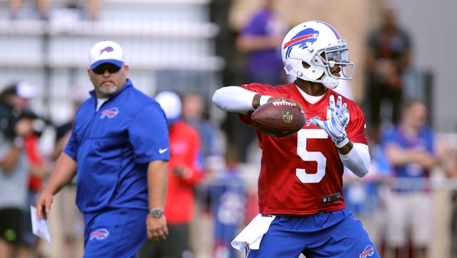 Bills quarterback  Tyrod Taylor looks downfield under the watchful eye of offensive coordinator Greg Roman. Developing Taylor's pocket presence and ability to throw over the middle is a priority this training camp.