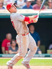 Mike Trout of the Los Angeles Angels of Anaheim hits an RBI single during the eighth inning against the Cleveland Indians at Progressive Field on August 30, 2015 in Cleveland, Ohio.