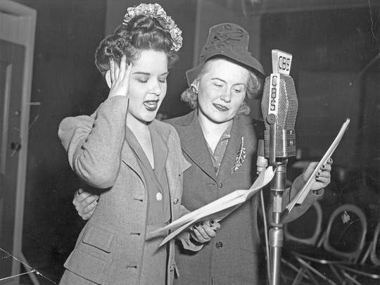 "Virginia Payne, right, performs in 1943 as Ma Perkins, with Nina Klowden, in the radio soap opera ""Ma Perkins,"" sponsored by P&G's Oxydol."