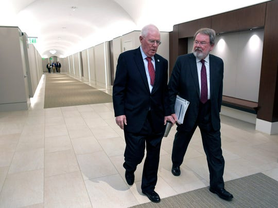 Reps. Charles Sargent and Steve McDaniel walk together in the state Capitol's new tunnel April 13, 2018.