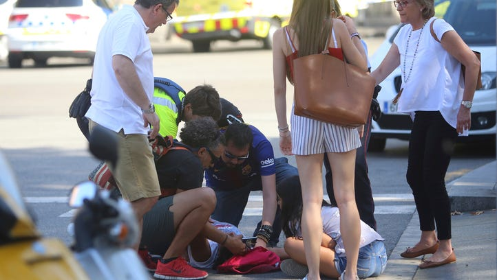 An injured person is treated in Barcelona.
