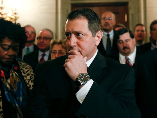 Assembly Majority Leader Joseph Morelle with fellow Democratic Assembly members behind him, pauses before talking to reporters at the Capitol about the arrest of Assembly Speaker Sheldon Silver on Thursday.