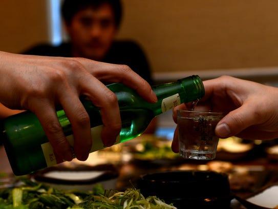 Soju, a popular Korean distilled alcoholic drink, is