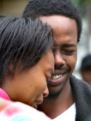 Taniasha Perkins and Willie Wilson, parents of 6-week-old Delano Wilson, show their anguish during a vigil Aug. 30, 2014 outside their home in the 500 block of Chase Street in Indianapolis. The vigil was conducted by Ten Point Coalition and Young Men Inc. Wilson reported to police that his son was taken from his arms about noon Aug. 27, 2014, in an alley on West Henry Street near the family's home.