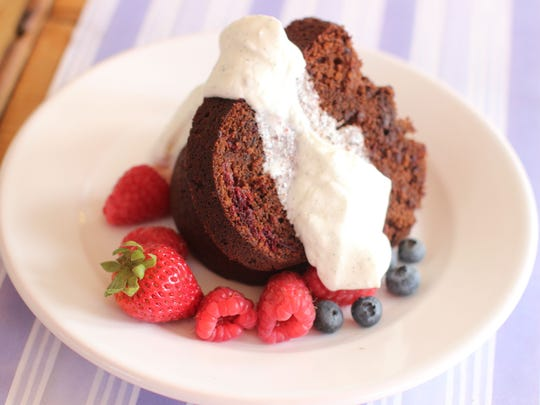 A slice of chocolate raspberry beet cake with buttermilk cream.