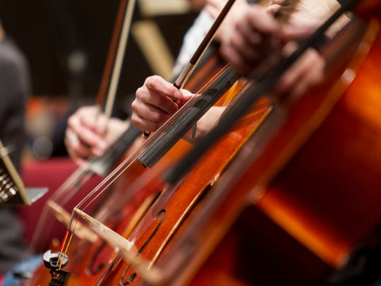The Great Falls Symphony cellos and other stringed instruments rehearse a piece ahead of an upcoming performance.
