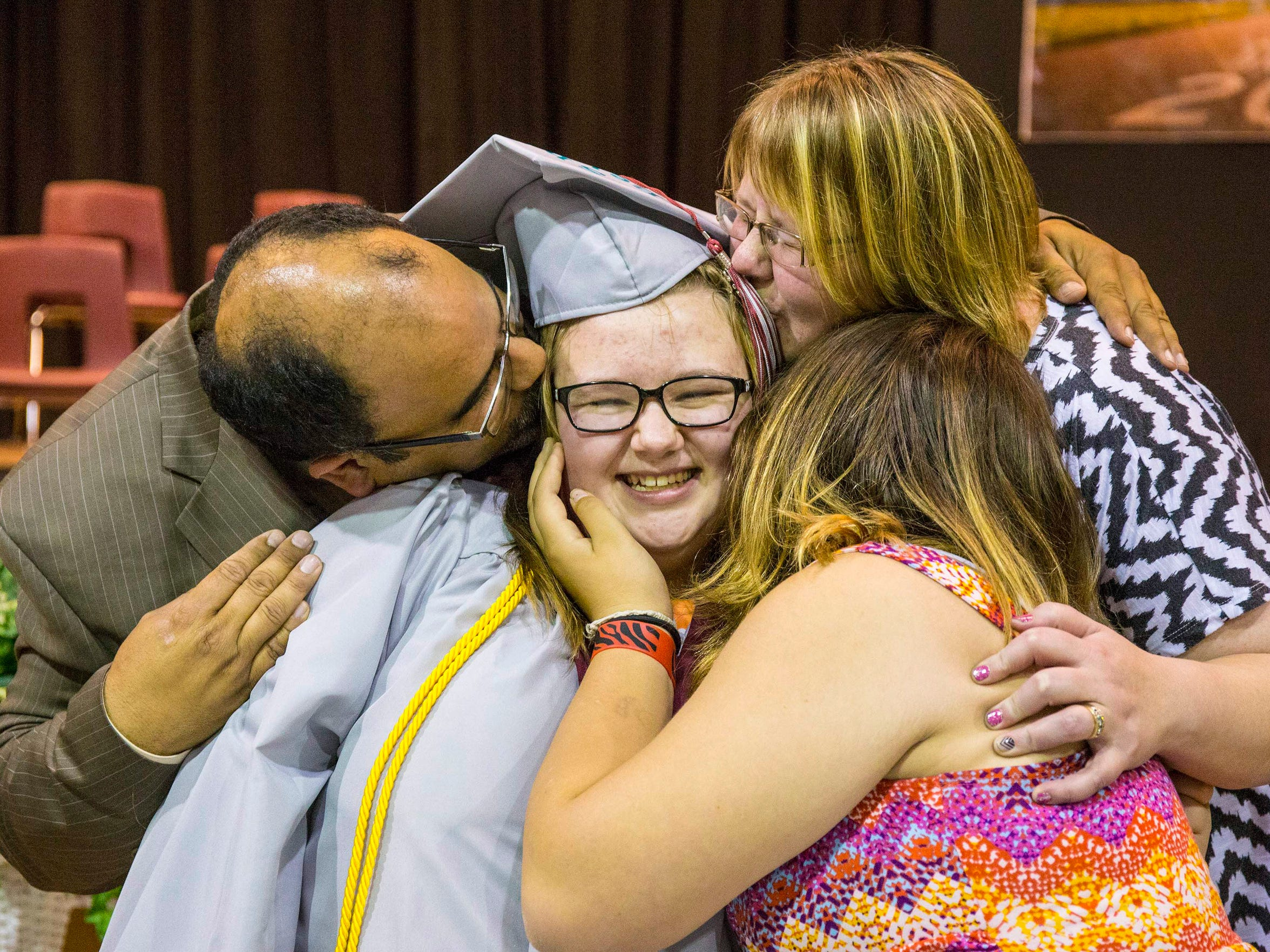 Shayla Banchs is hugged and kissed by her family after Corwith-Wesley-Lu Verne High School's final graduation May 17. Thirteen students received diplomas.