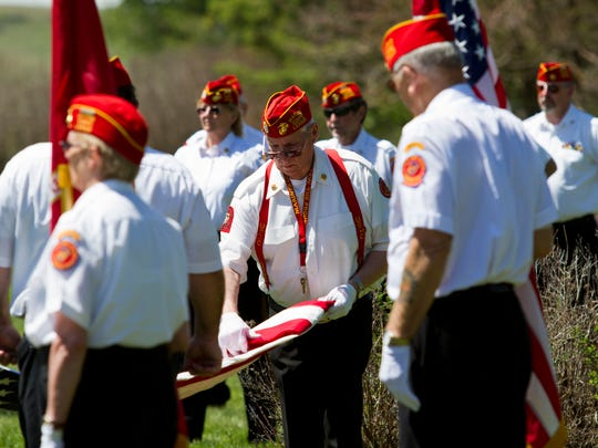A group of about a dozen veterans and another dozen or so community members gathered at the Manchester Cemetery to pay their respects to the men and women of the armed forces buried there.