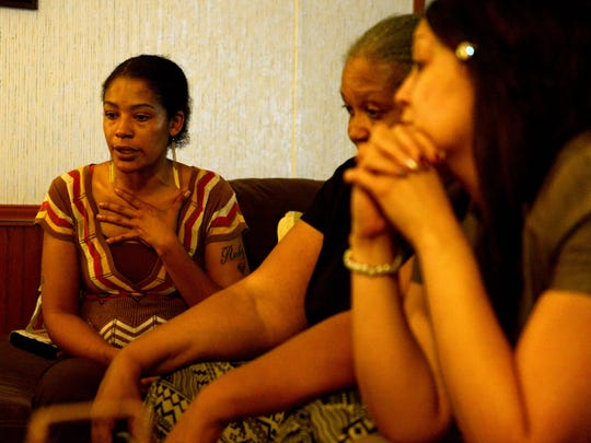 From left, Vallie Evita Bowman sits with her mother Alma Bowman and sister SoRay Bowman Woods reflect on the murder of Walter Rodney Bowman at the family's home Thursday evening.