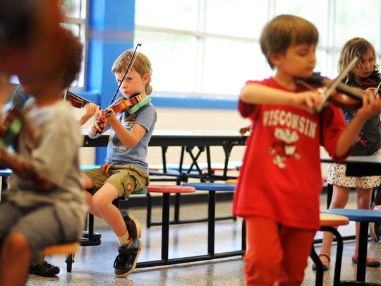 Hall Fletcher Elementary School students listen to instruction during the MusicWorks! program, a free after-school program offered at the school.
