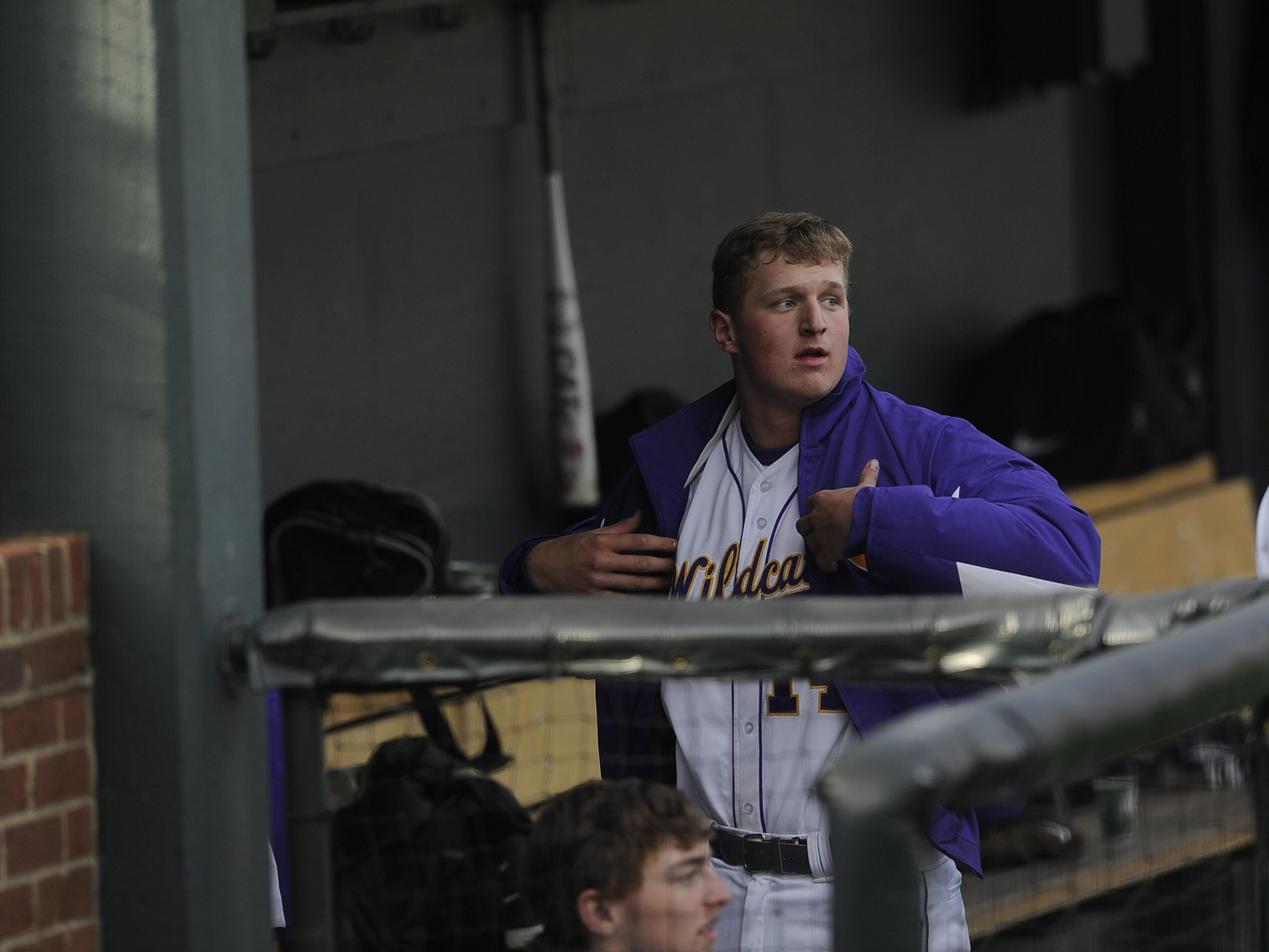 Clarksville's Donny Everett (14) puts on his jacket in the dugout during a game against Northwest last year at Vanderbilt. Everett was drafted in the 29th round Wednesday by the Milwaukee Brewers.