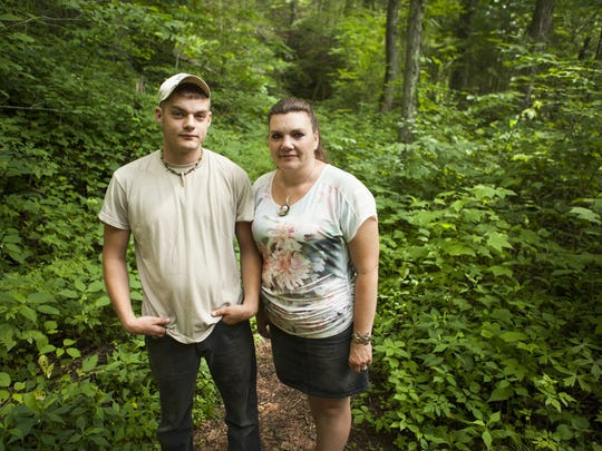 Dalton Hoerner, 20, and his mom, Bridget Hoerner, stand together at the fork in the Ramsey's Draft trail where they took a wrong turn and ended up becoming lost just miles from their home in West Augusta for 14 hours.