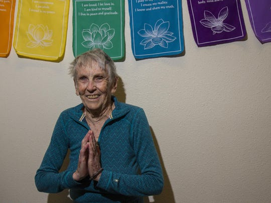Starshine practices yoga at Wellness Yoga in downtown