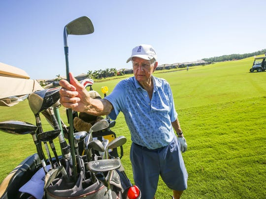 Bob Nelson, 91, grabs a club out of his bag as he plays a round of golf. Alfred Spungin, 92, and Bob Nelson, 91, are seasoned golfers who have a lot of wisdom to share about the game and life in general. They are two of the oldest golfers at Pelican Preserve and aren't slowing down anytime soon. June, 17, 2015.