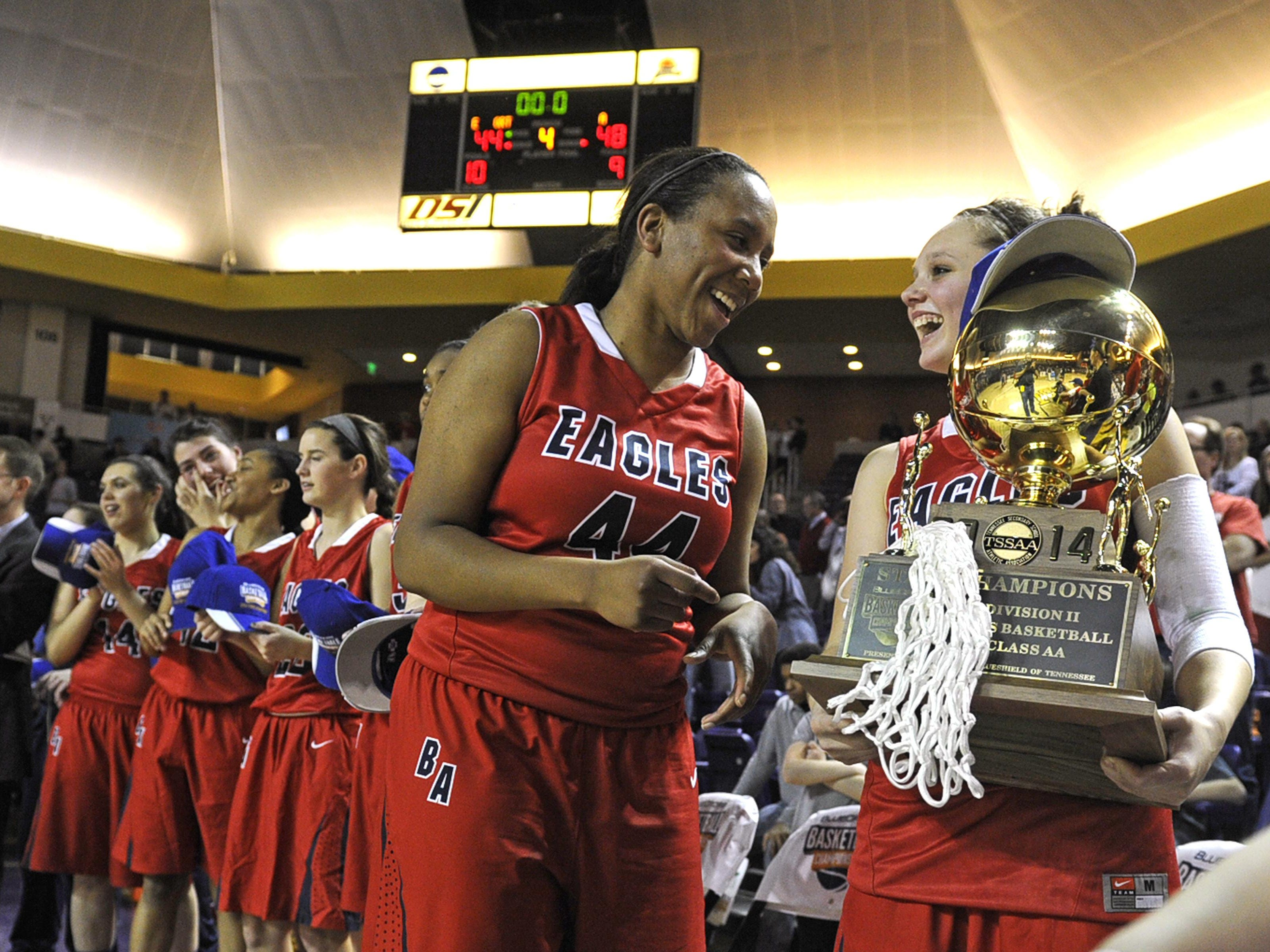 Brentwood Academy's Tyra Avery (44) and Maren Kreid (10) celebrate their 48-44 win over Ensworth in the DII-AA girls basketball state championship game at Lipscomb University in 2014 in Nashville.