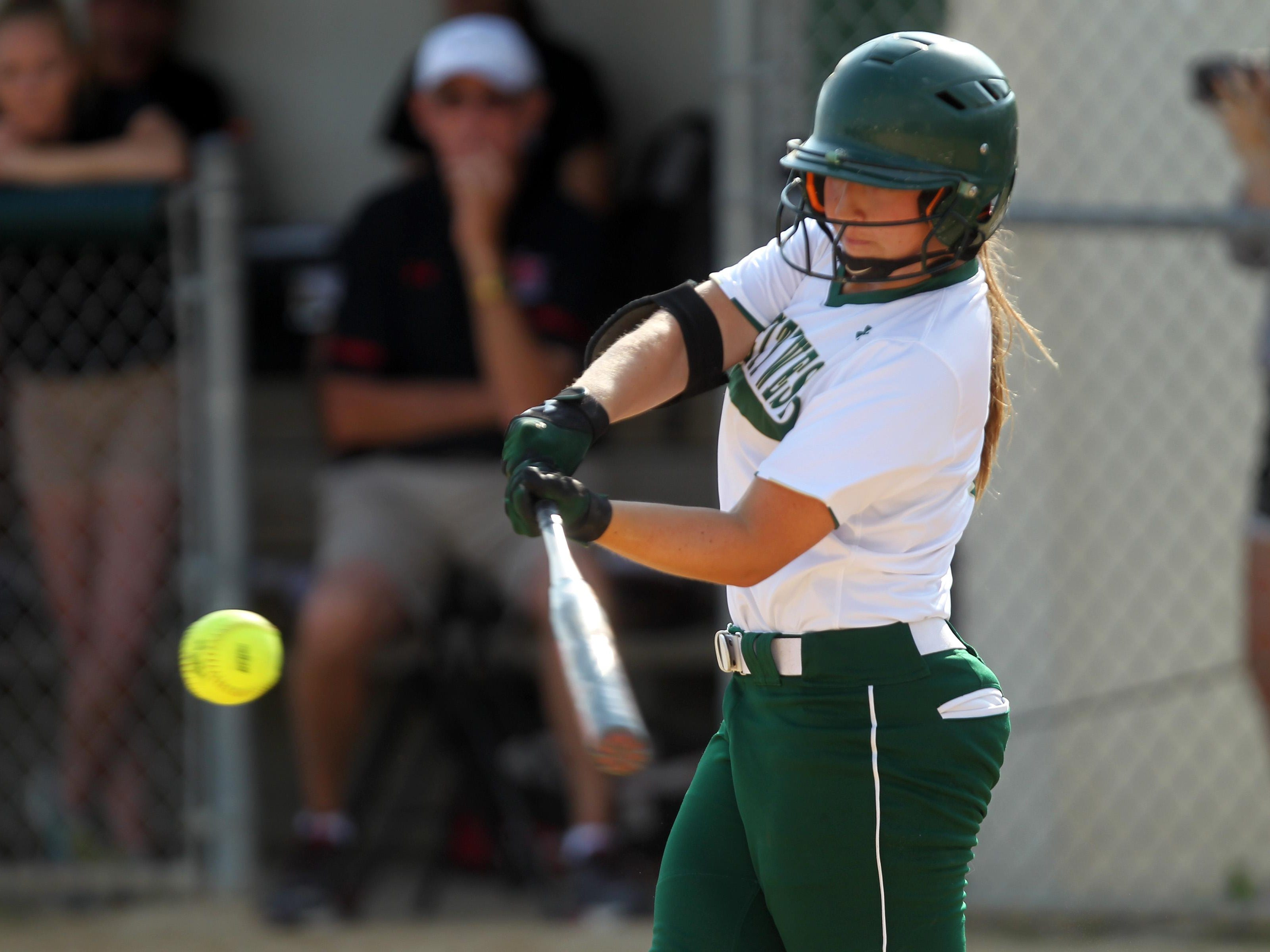 West High's Adara Opiola takes a swing during the Women of Troy's game against Linn-Mar on Thursday, July 9, 2015. David Scrivner / Iowa City Press-Citizen