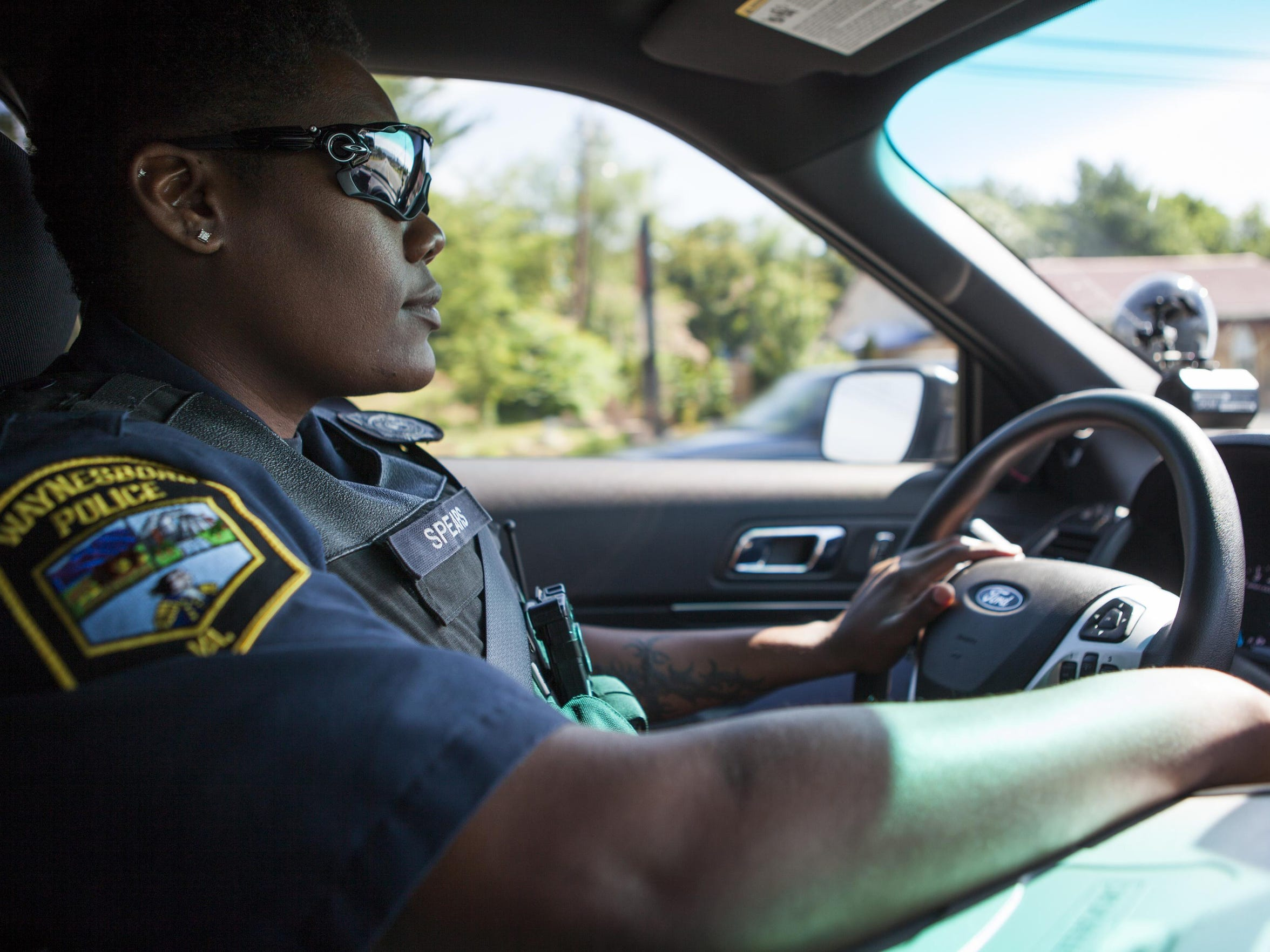 Waynesboro police officer Shamica Spears rides in her