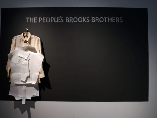 The fiber exhibition includes stations like this one at which visitors can learn to produce textile products — in this case, a Brooks Brothers button-down shirt.