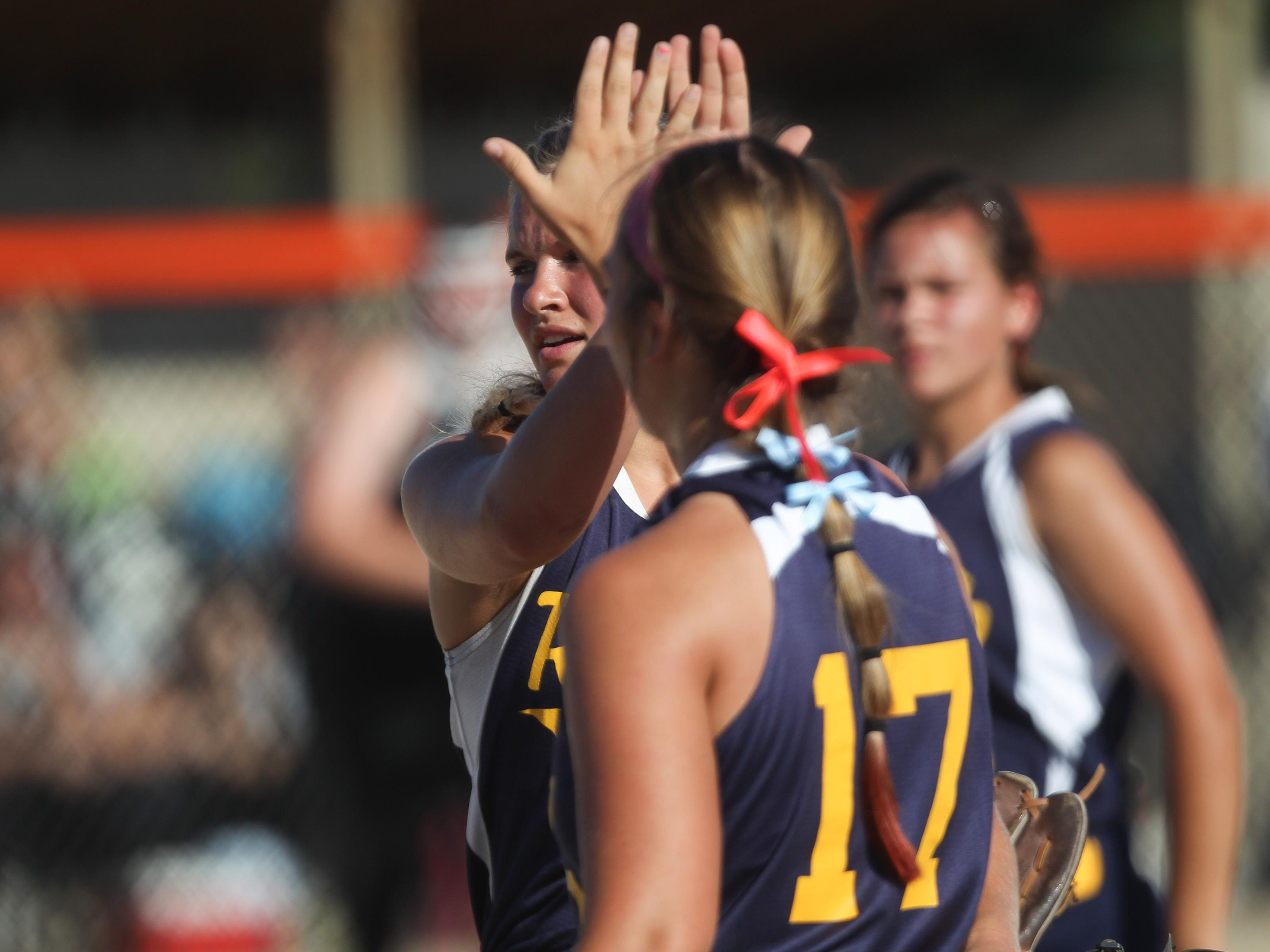 Regina pitcher Sarah Lehman gets a high-five from teammate Hannah Stein during the Regals' Class 2A regional championship against Collins-Maxwell/Baxter in Grinnell on Monday, July 13, 2015.