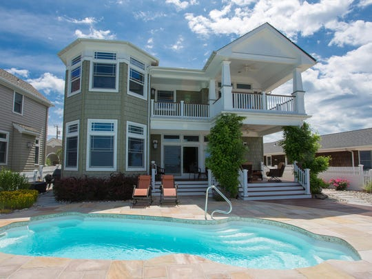 This Lavallette mansion has a heated saltwater pool and covered decks.