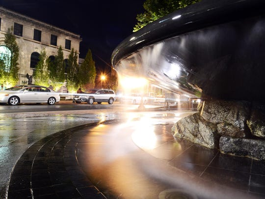 TOP: A 30-second exposure makes the water from the Pack Square fountain look soft as traffic moves by in the background.