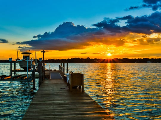 A breathtaking sunset is seen from this Fair Haven mansion.