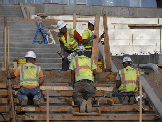 Construction workers are shown working on the Minnesota Vikings' new stadium in Minneapolis, Wednesday, Aug. 26, 2015. The new wage theft law went into effect on July 1 and protects Minnesota workers from being shorted pay.