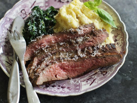 Marinated flank steak with seared spinach.