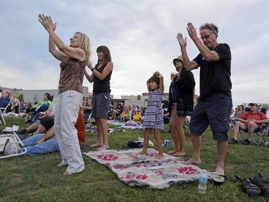 Adults dance to the music of We Banjo 3 during the Levitt AMP Sheboygan Music Series on Aug. 6, 2015 in Sheboygan.