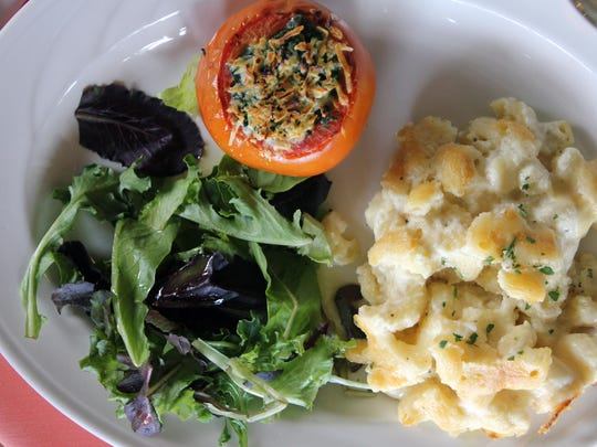 The main course prepared by Chef Owen. Mac 'n cheese, salad with Dijon vinaigrette, and spinach souffle stuffed tomato.