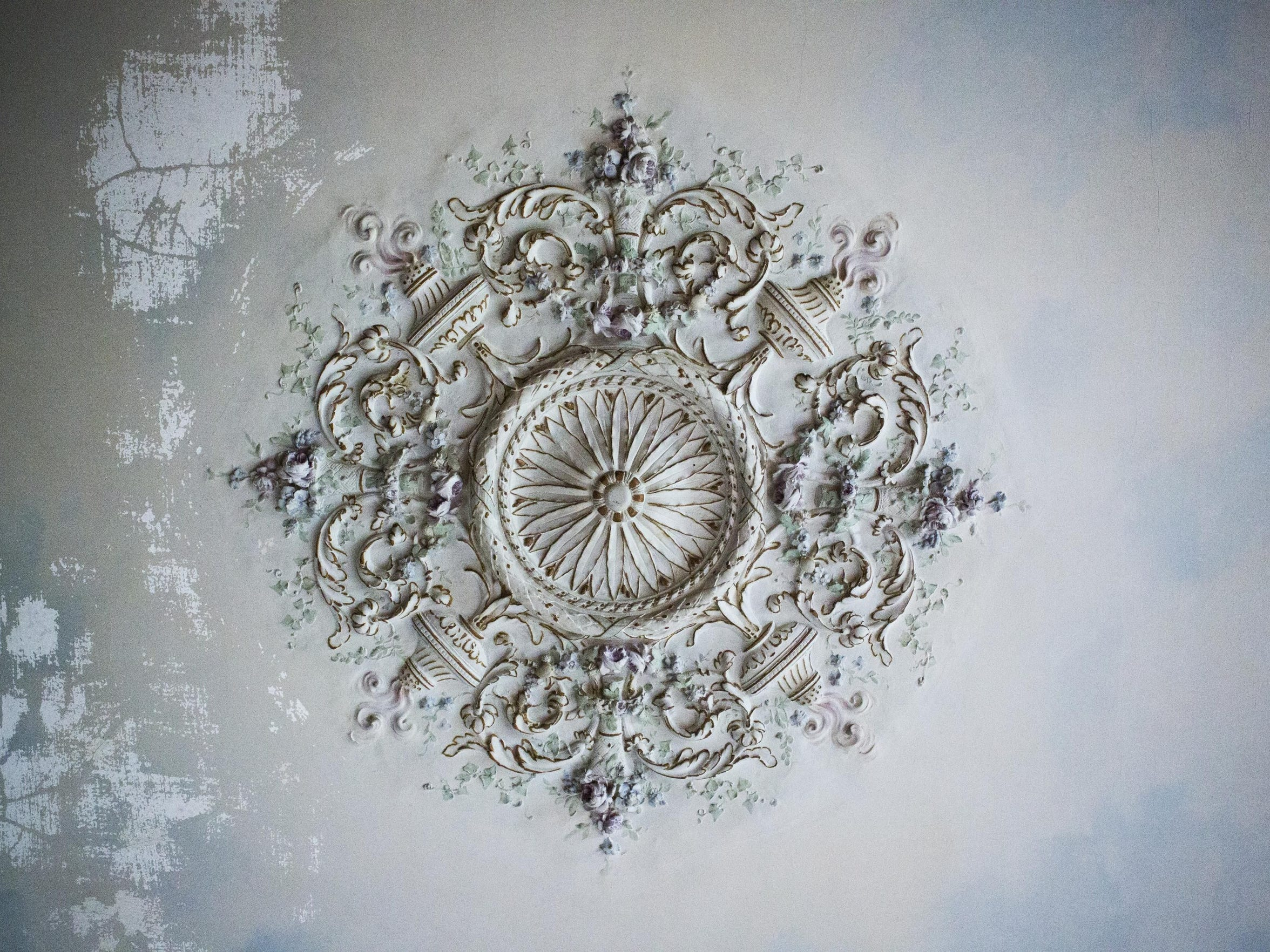 An intricately designed ceiling piece is on display