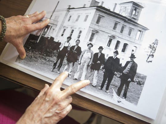 Sandi Dulaney points out James Dooley, third from right, the original owner of Swannanoa, in a photo taken during the construction of the palace.