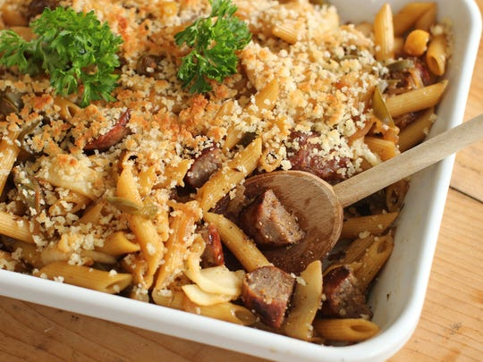 This Sept. 21, 2015 photo shows bratwurst pasta bake with caramelized onions, peppers and apples in Concord, NH.