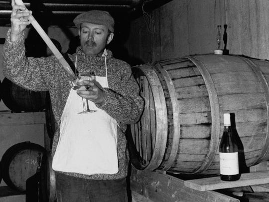 Winemaker and owner Jim Doolittle taking a barrel sample at Frontenac Point, circa 1984.