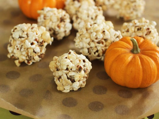 With the popcorn popped, you can go either sweet or savory when making popcorn treats as with these marshmallow popcorn balls.