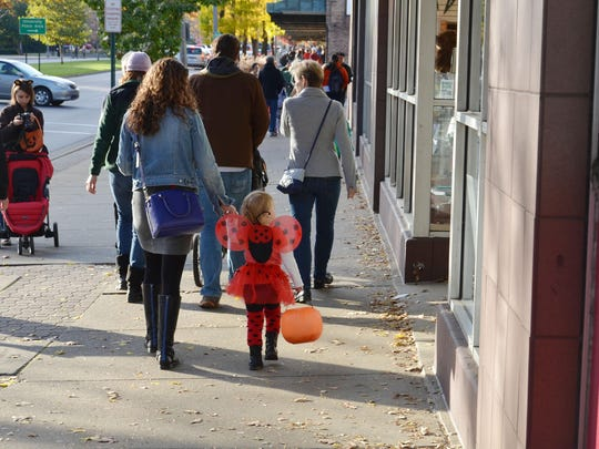 Trick-or-treaters take to the streets in search of candy.