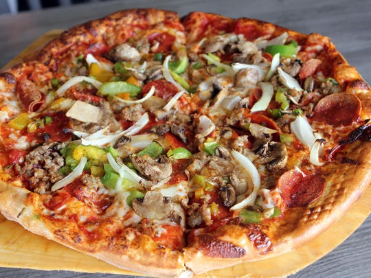 One of the Brewery's favorites is the pizza supreme, made fresh in-house.