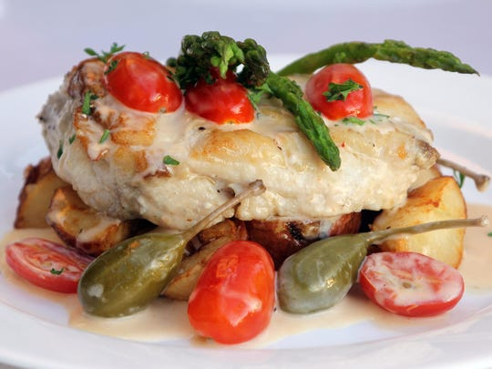 Black grouper with caper berries and Meyer lemon sauce, along with roasted potato and asparagus