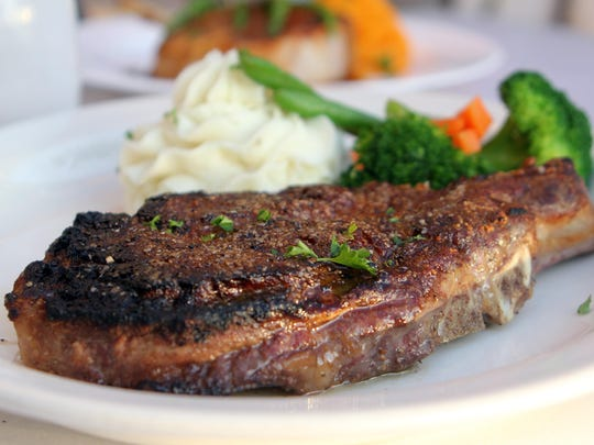 Always popular is the bone-in ribeye steak with veggies and garlic whipped potato.