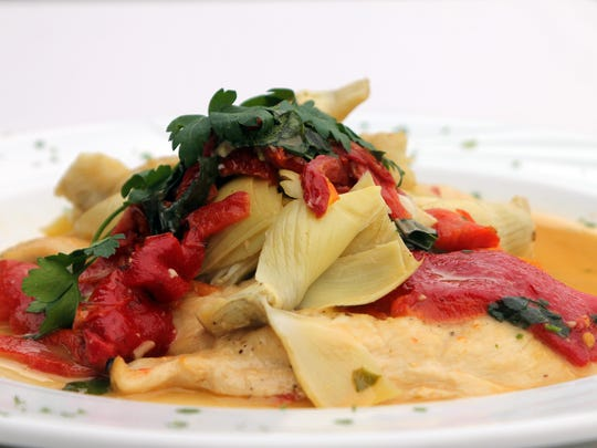 Arturo's chicken Abbondanza is chicken sautéed in a white wine sauce and served with sun-dried tomatoes, artichoke hearts and roasted red peppers.