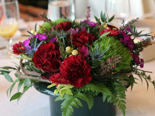 Table floral arrangements complement the special luncheon.