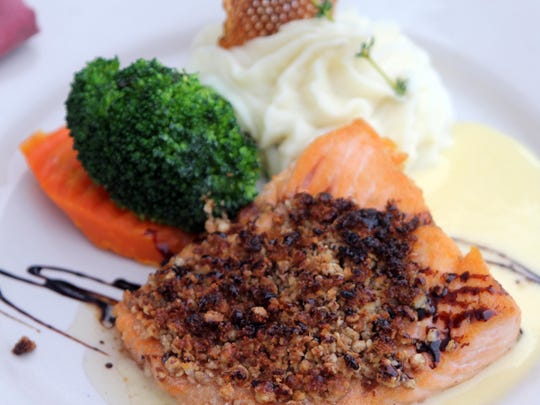 The pecan-encrusted salmon has a balsamic glaze, and is served with potato and vegetables.