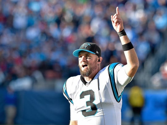 Nov 15, 2015; Nashville, TN, USA; Carolina Panthers quarterback Derek Anderson (3) sings along with Lee Greenwoods (not pictured) I AM Proud To Be An American during a time out in the second half against the Tennessee Titans at Nissan Stadium. Carolina won 27-10. Mandatory Credit: Jim Brown-USA TODAY Sports