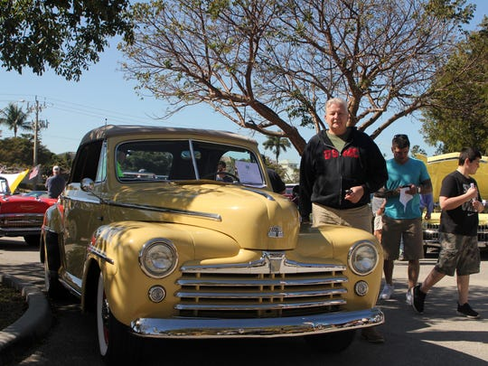 Former Vietnam Marine Dale Nash stands with his 1947 Ford convertible 'restorod,' which took him four years to get into this condition.