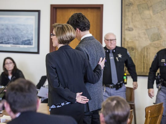 Attorney Jaye Rancourt, left, places her hand on convicted St. Pauls School graduate Owen Labrie's back as the judge declares his decision to revoke bail in Merrimack County Superior Court in Concord, N.H., on Friday.