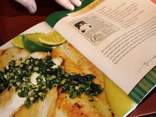 Part of the layout for Chef Owen's recipe for lionfish is seen in the open book.